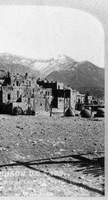 Los Pueblos de Taos in 1878: View of Taos Pueblo, New Mexico&#x3B; shows adobe pueblo dwellings, Native Americans, ovens, and Taos Mountain.