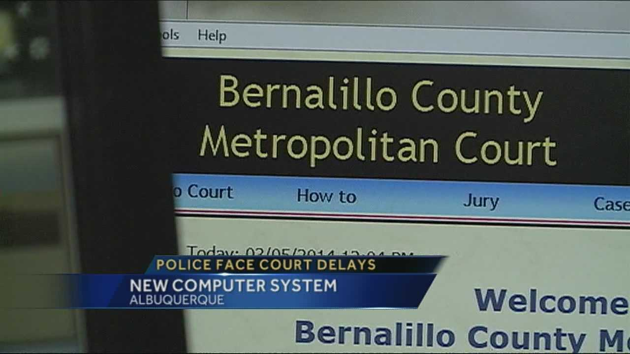 The new computer system at metro court is causing a problem for officers and creating a backlog of paperwork.