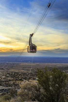 Sandia Peak TramSandia Peak Tram car heading up the mountain at sunset.