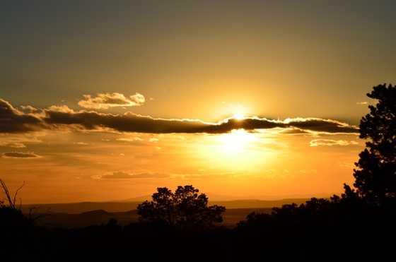 Golden SunsetTaken off of I-25 just outside of Santa Fe New Mexico heading toward Pecos New Mexico.