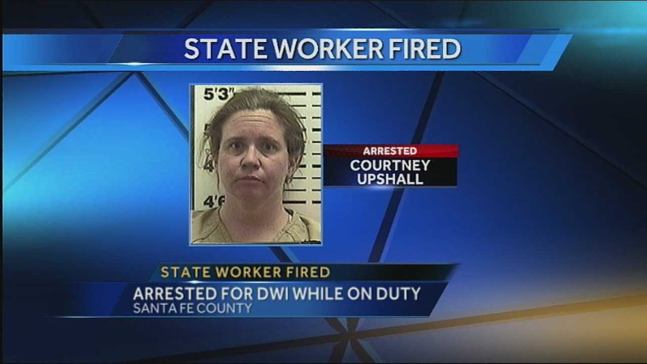 Santa Fe County sheriff's deputies say they found 36-year-old Courtney Upshall from Albuquerque drunk and passed out inside her state vehicle while on duty Wednesday.