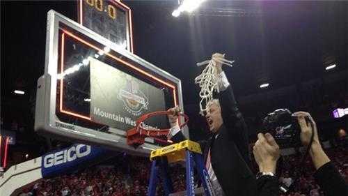 Craig Neal cuts down the nets