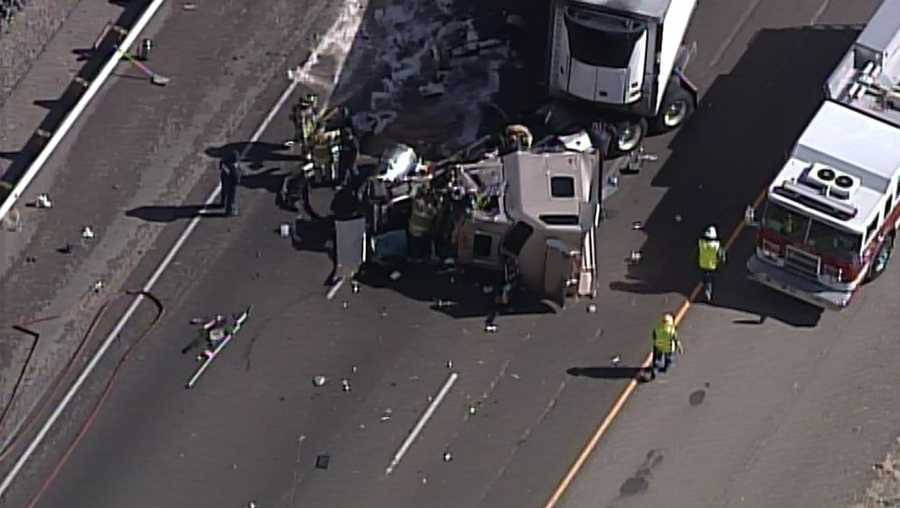 See photos from Thursday crash involving two semi-trucks.