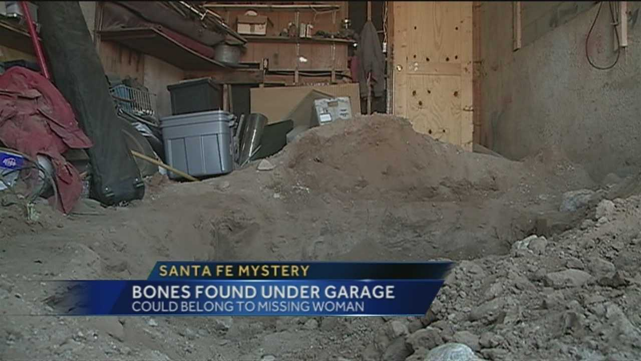 Santa Fe police are digging for the bones of a woman who disappeared in 1952 underneath a house garage.