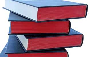 A challenge is defined as a formal, written complaint, filed with a library or school requesting that materials be removed because of content or appropriateness. Click through the slideshow to see the most challenged books of 2013.