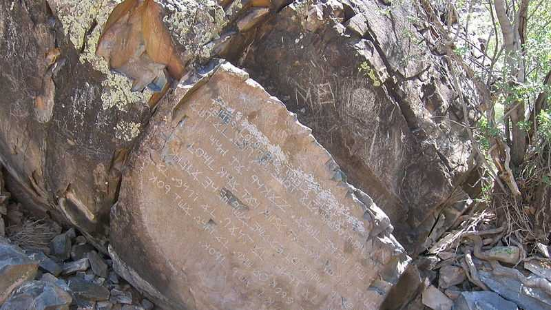 Also known as Commandments Rock and Decalogue stone, the site is at the base of Hidden Mountain about 16 miles west of Los Lunas. Nine rows of 216 characters were chiseled at a 150 degree angle into the north face of a boulder of volcanic basalt, according to the New Mexico State Lands Office.