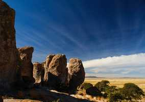 In southwestern New Mexico, there are several masses of rock that jut out of the ground like buildings in a city, writes Trento.