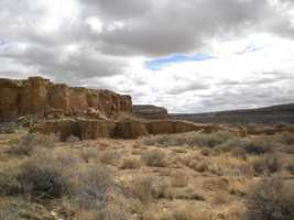 Numerous roads spread outward in straight lines from a twelfth-century Anasazi site, some of which extend as many as 60 miles. (Photo: Chaco Canyon)