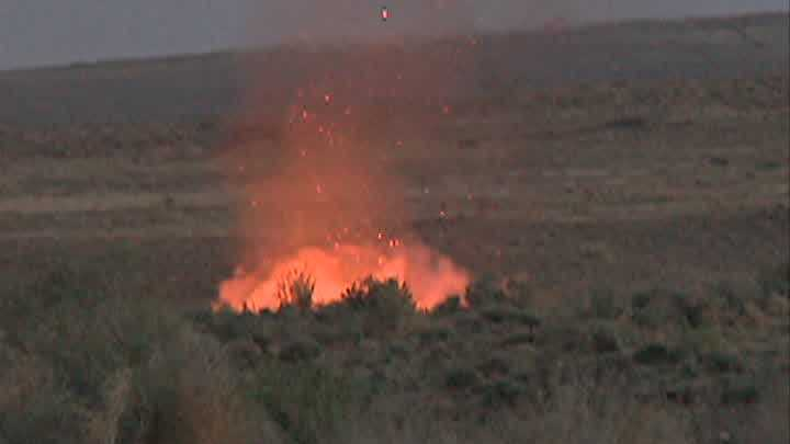 A wildfire was burning along Paseo Del Norte Wednesday night.