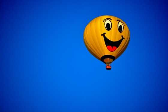 23. Wake up early during one day to watch a balloon or two float across the sky