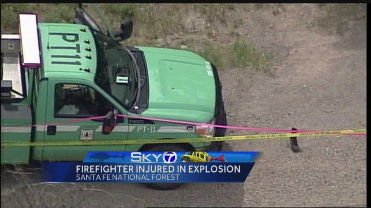 A small blast that left a firefighter injured in the Santa Fe National Forest has authorities wondering whether the jar that exploded was meant to harm someone.