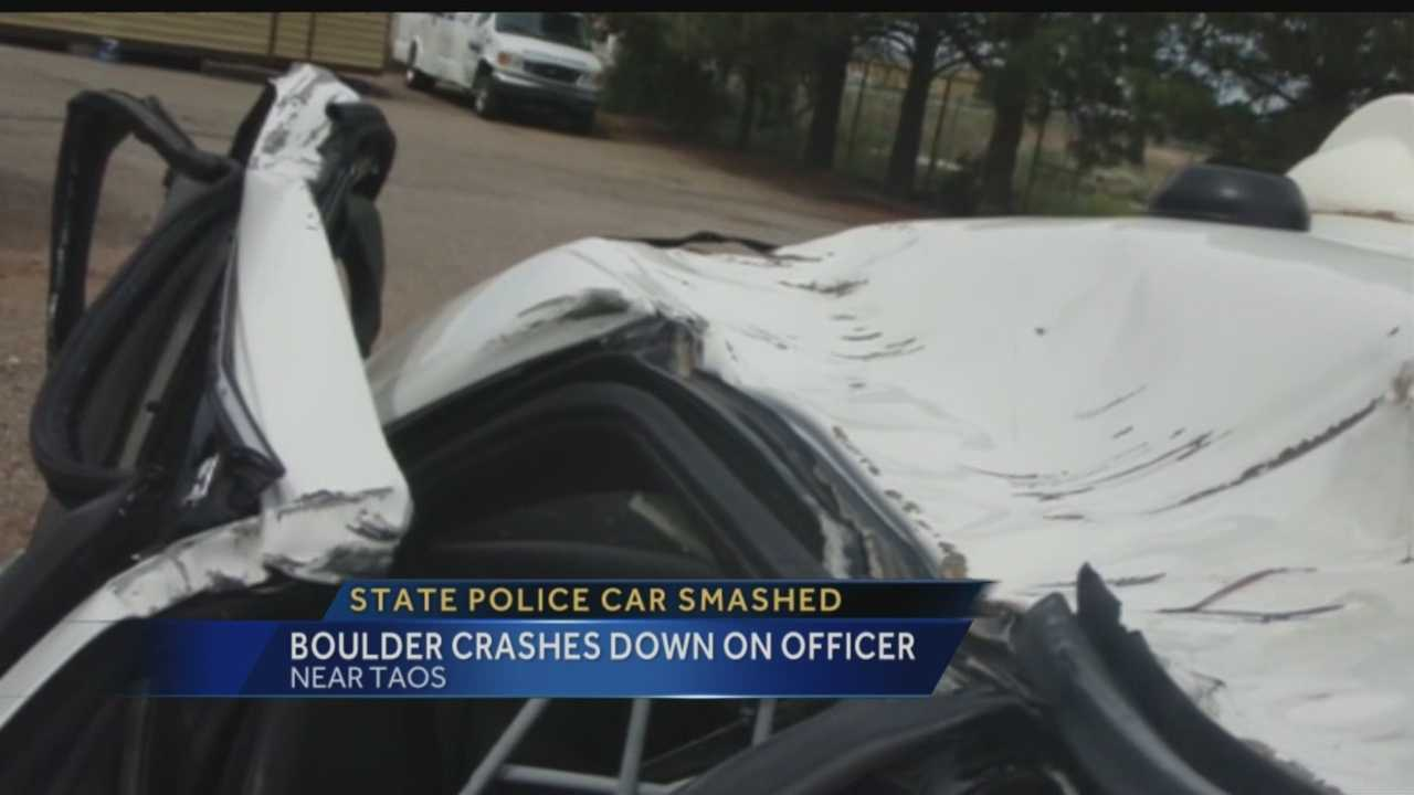 Boulder crashes down while officer was driving