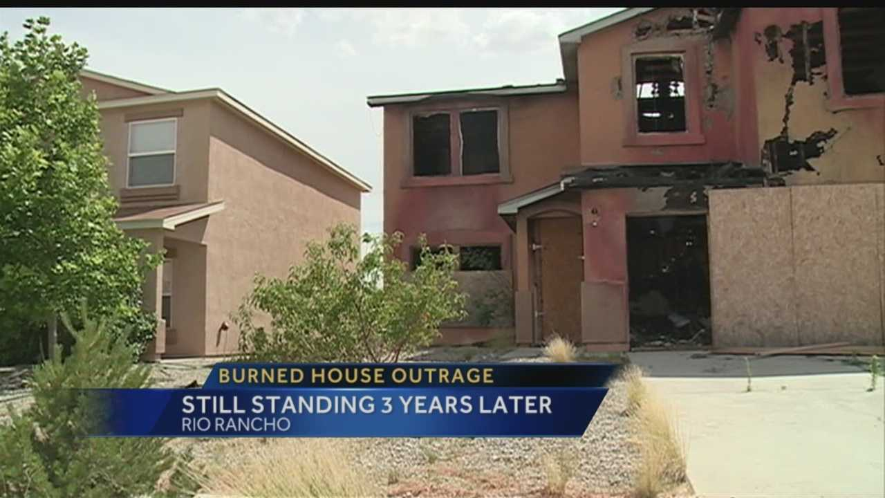 Neighbors in Rio Rancho are outraged the city hasn't torn down a home destroyed by a fire three years ago.