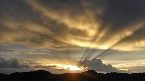 Sun setting with rain cloud from u local member Nicolas Arambula