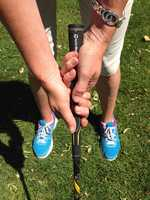 "Here's an example of a bad or ""strong grip."" The bottom hand is under the club, and it leads to a closed face, which causes you to hook the ball."