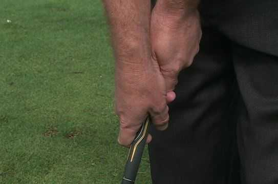 """Here's an example of a bad or """"weak grip."""" The bottom hand is over the top, and it leads to an open club face, which causes you to slice the ball."""