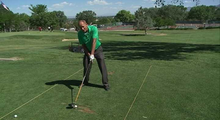 Many amateurs play the ball too far back in their stance, causing the ball to go high in the air but not far.
