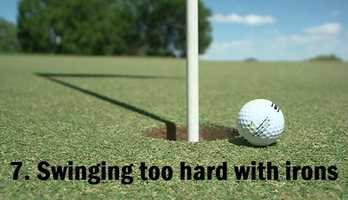 7.Swinging too hard with your irons