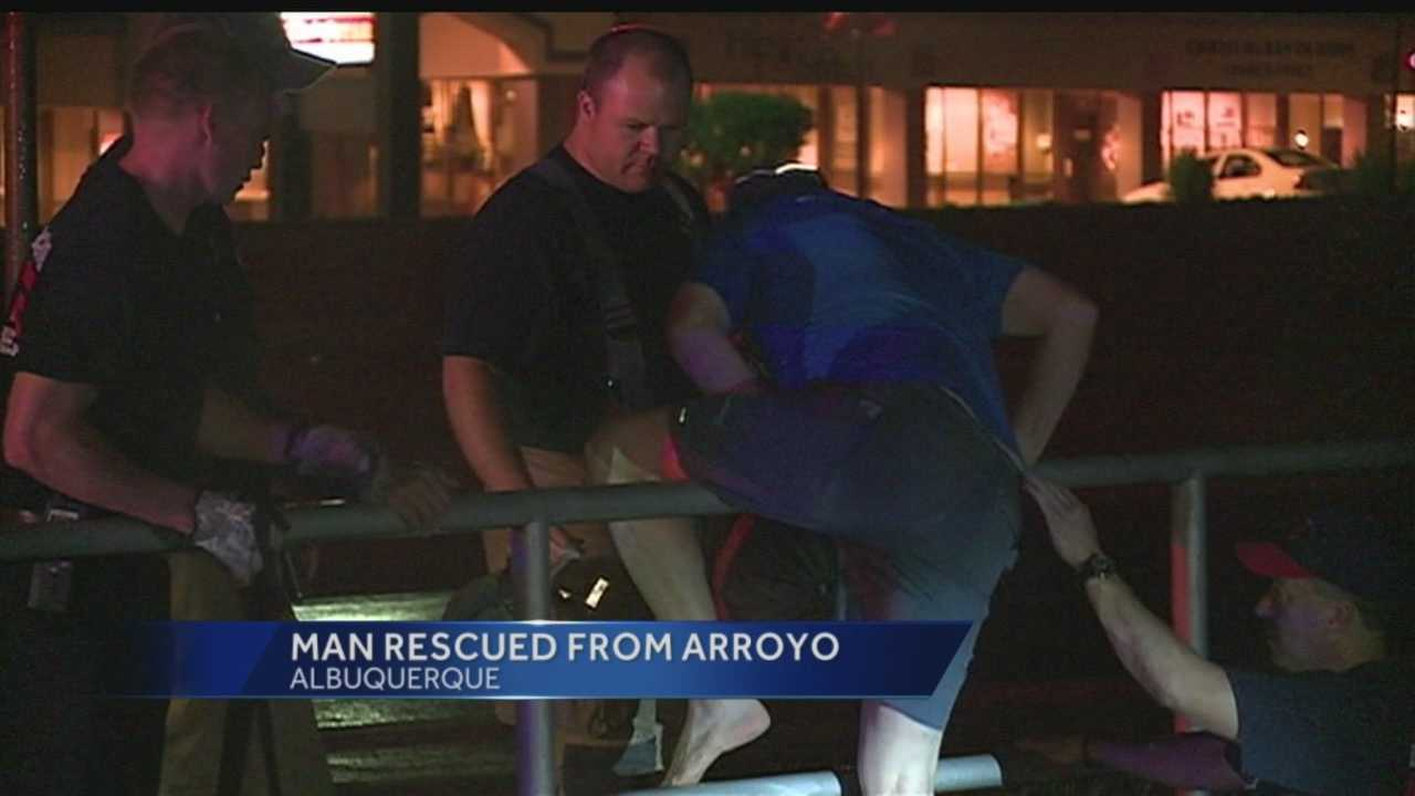 Some quick heavy rain hit Albuquerque Tuesday night, which proved dangerous for one man, who had to be rescued from an arroyo.