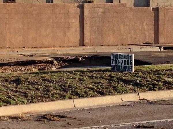 See photos of a large sinkhole that opened up overnight in northwest Albuquerque.