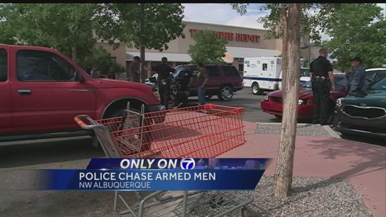 Albuquerque police chased a pair of men armed with guns through crowded stores Friday.