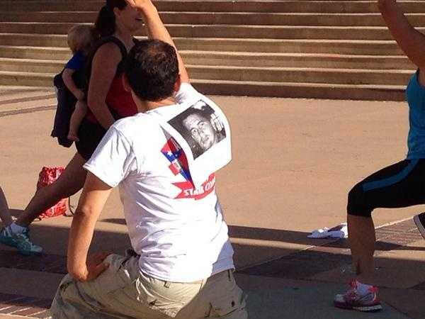 Each participant in the community stair climb has a photo on their back. They are walking memory of that person.