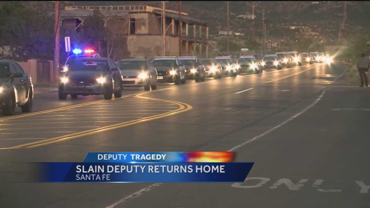 The body of 29-year-old Santa Fe Sheriff's Deputy Jeremy Martin returned to Santa Fe Wednesday in a procession that his brothers in blue called a hero's homecoming.