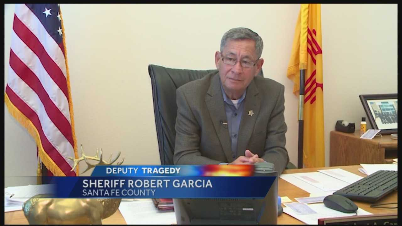 Days after one of his deputies was shot and killed and another was charged in the killing, Santa Fe County's sheriff is hoping things will get better as time goes by.
