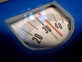 Losing as little as 5 percent of body weight can help someone significantly reduce their cholesterol levels.