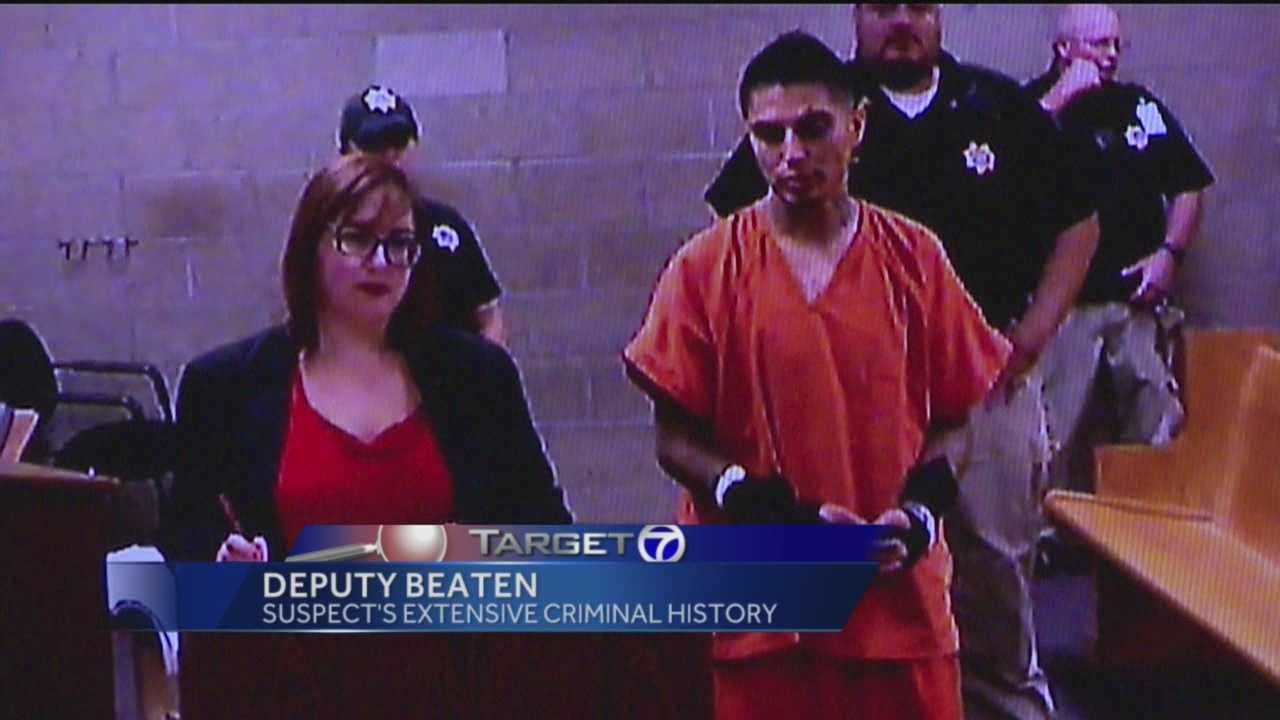 A man is accused of beating a deputy so badly she had to go to the hospital.