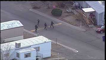 See photos of the search for an armed person in southeast Albuquerque.