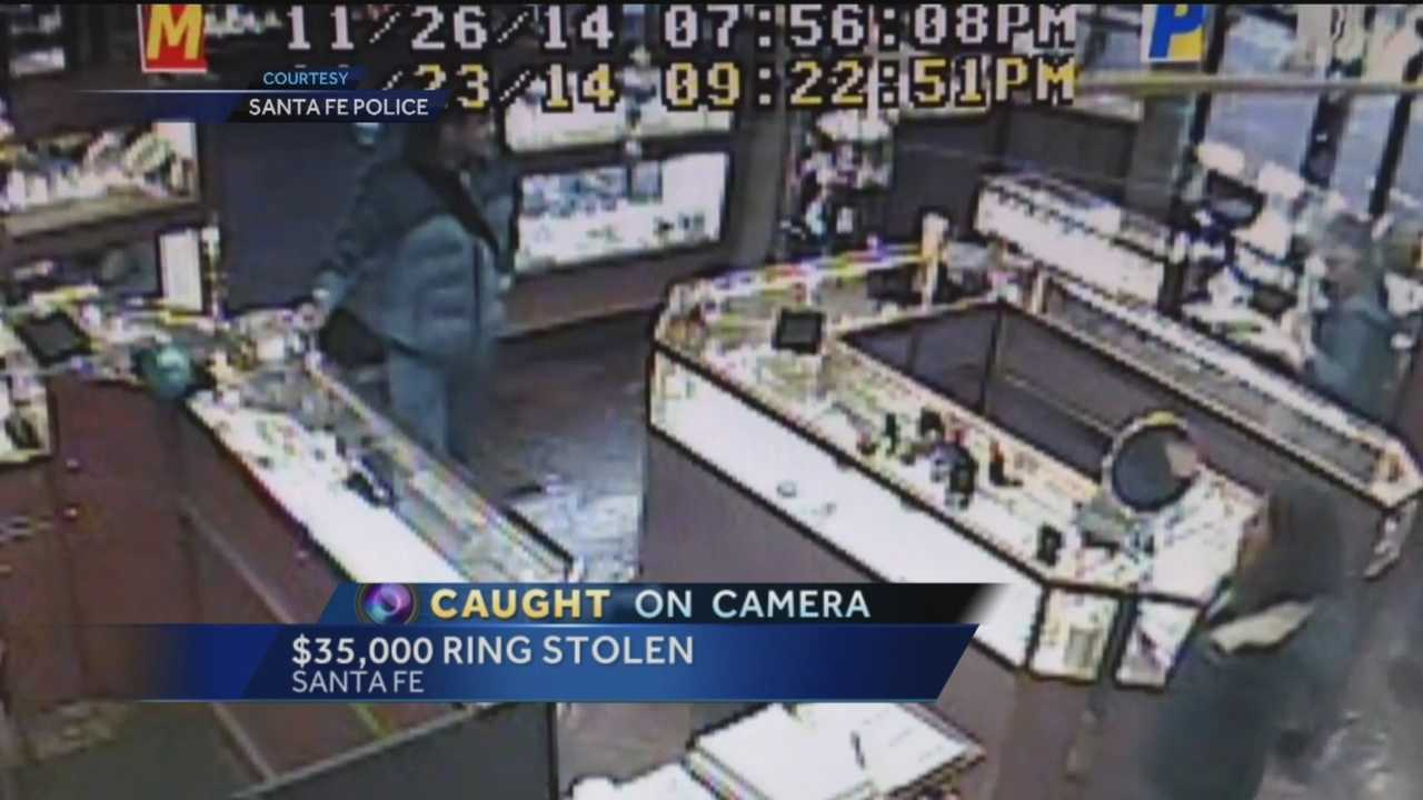 A man and woman teamed up to trick a store employee out of a $32,000 ring last month.