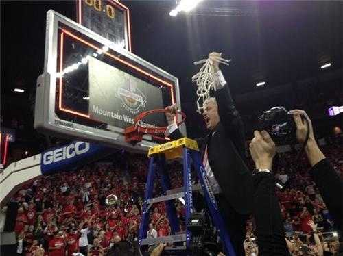 In his first year as head coach of UNM's men's basketball team, Craig 'Noodles' Neal cuts down the net after winning a Mountain West Conference tournament championship.
