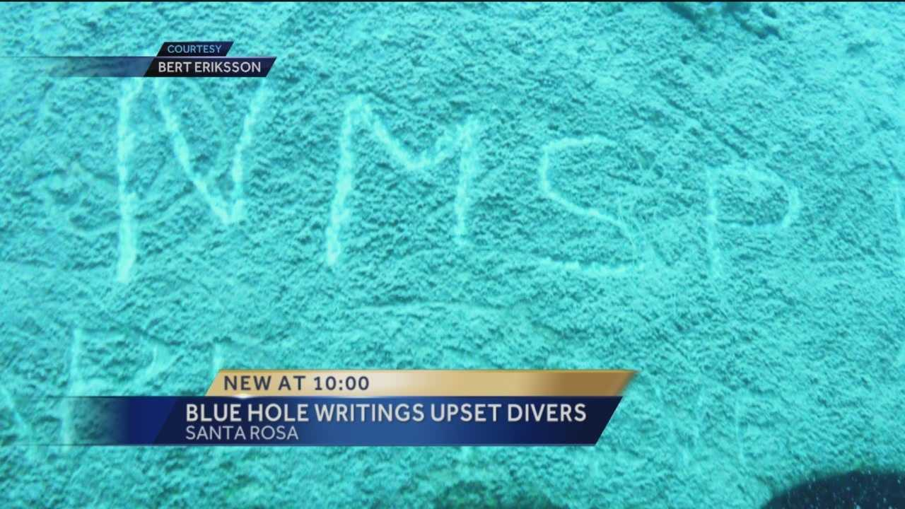 Some are upset after the learning the New Mexico State Police Dive Team wrote their name on the rock at Blue Hole in Santa Rosa.