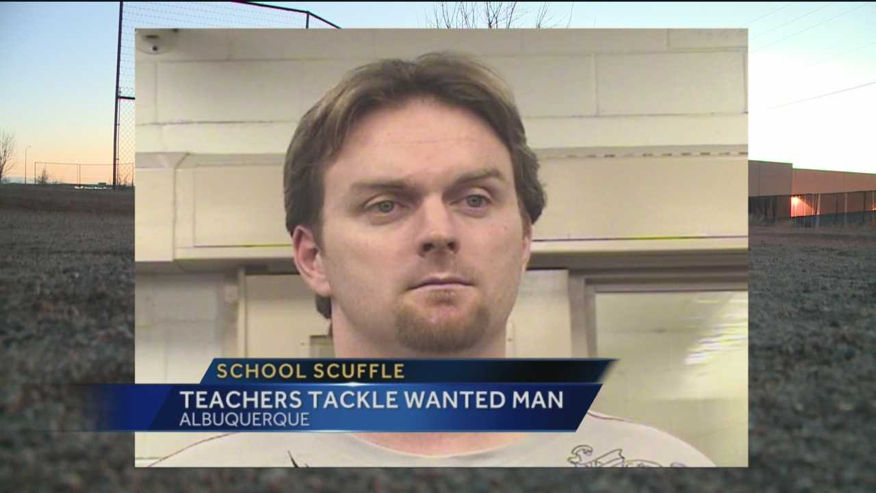 Two Albuquerque teachers stopped and tackled a man who was wanted by federal authorities.
