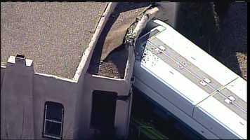 See photos of an Albuquerque city bus that crashed into a home Thursday monring near Girard and Lomas.