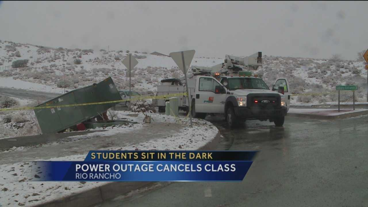 Students at Rio Rancho High School were dismissed from class early Wednesday morning after a car slid off the road near the school and knocked out the power.