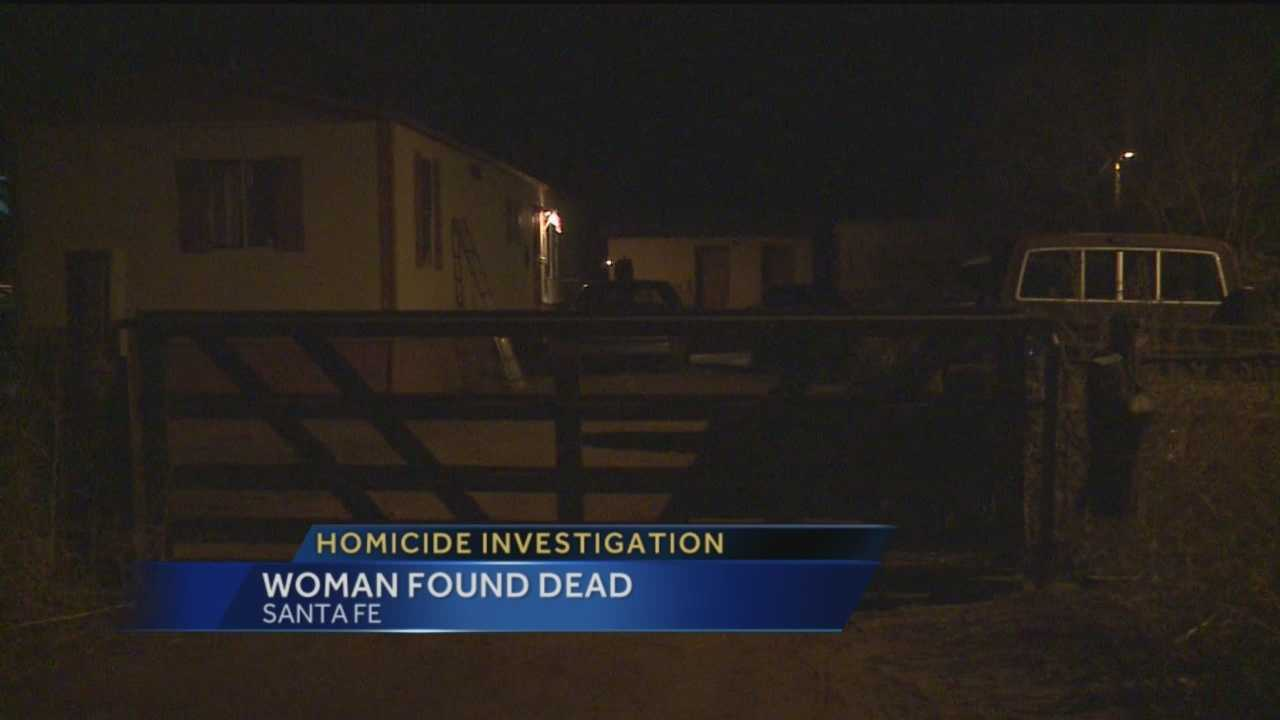 The Santa Fe Sheriff's Office is investigating after a woman was found dead in her own backyard.