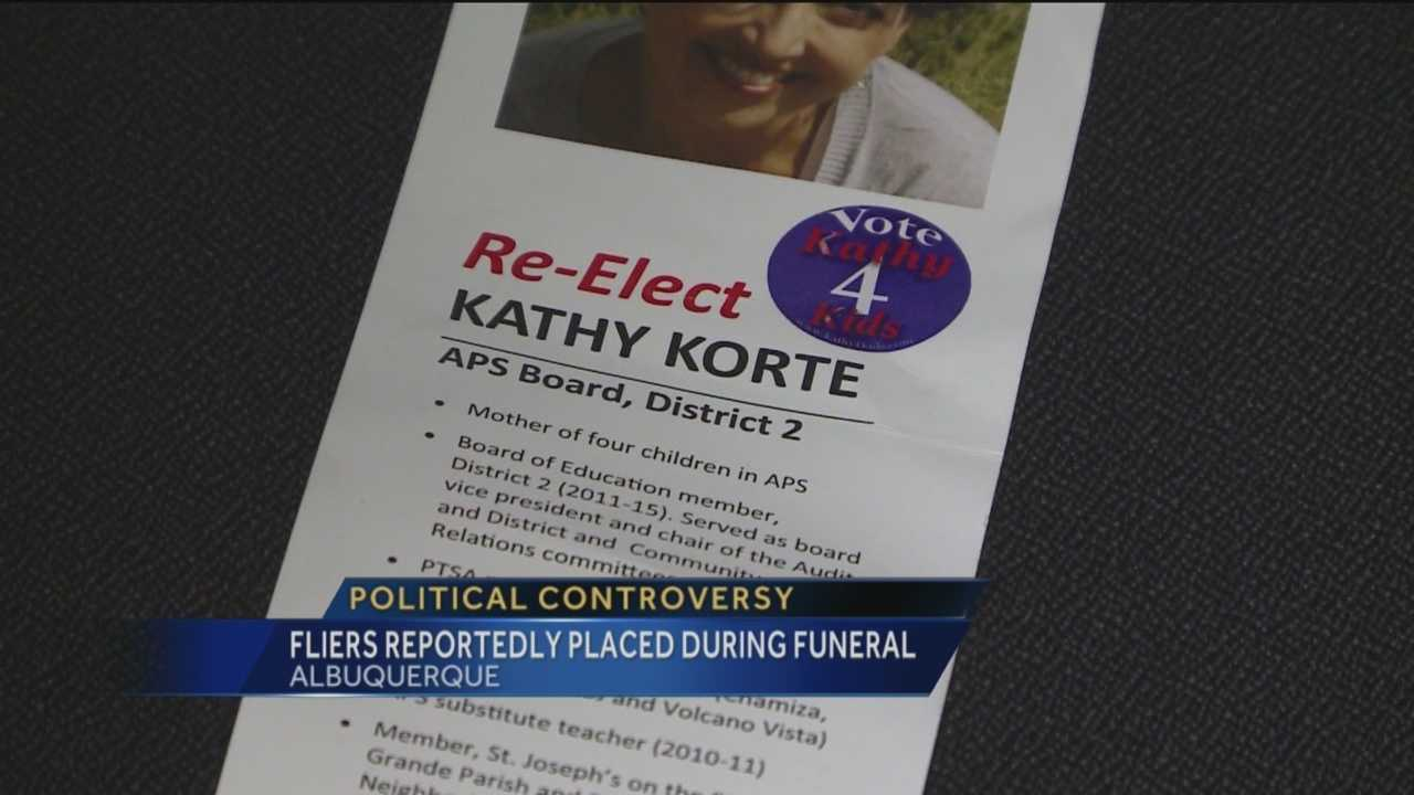 Some who attended a recent memorial service claim a candidate for the Albuquerque Public Schools board put fliers on cars nearby.