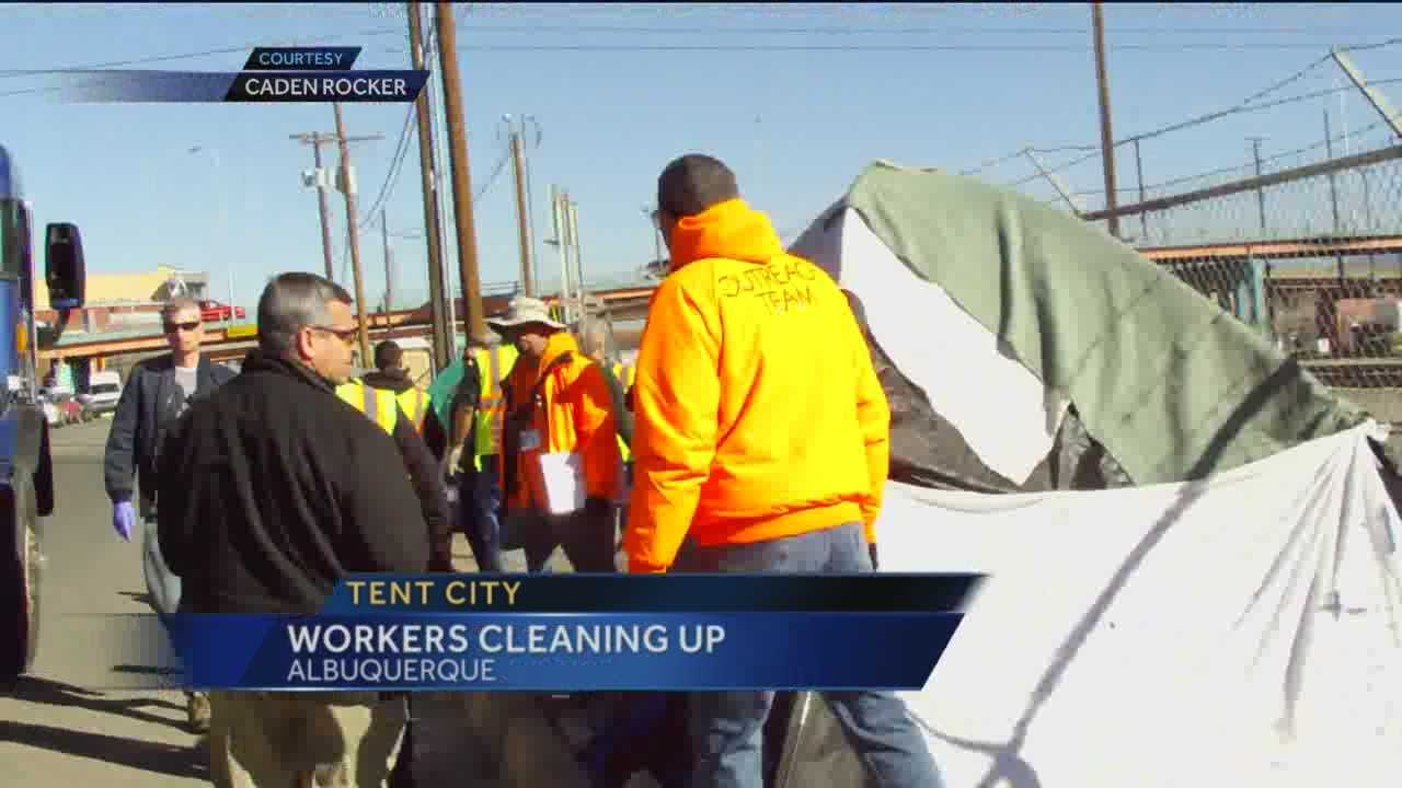 Clean up crews started tearing down unoccupied tents at a homeless camp near downtown Albuquerque on Friday.