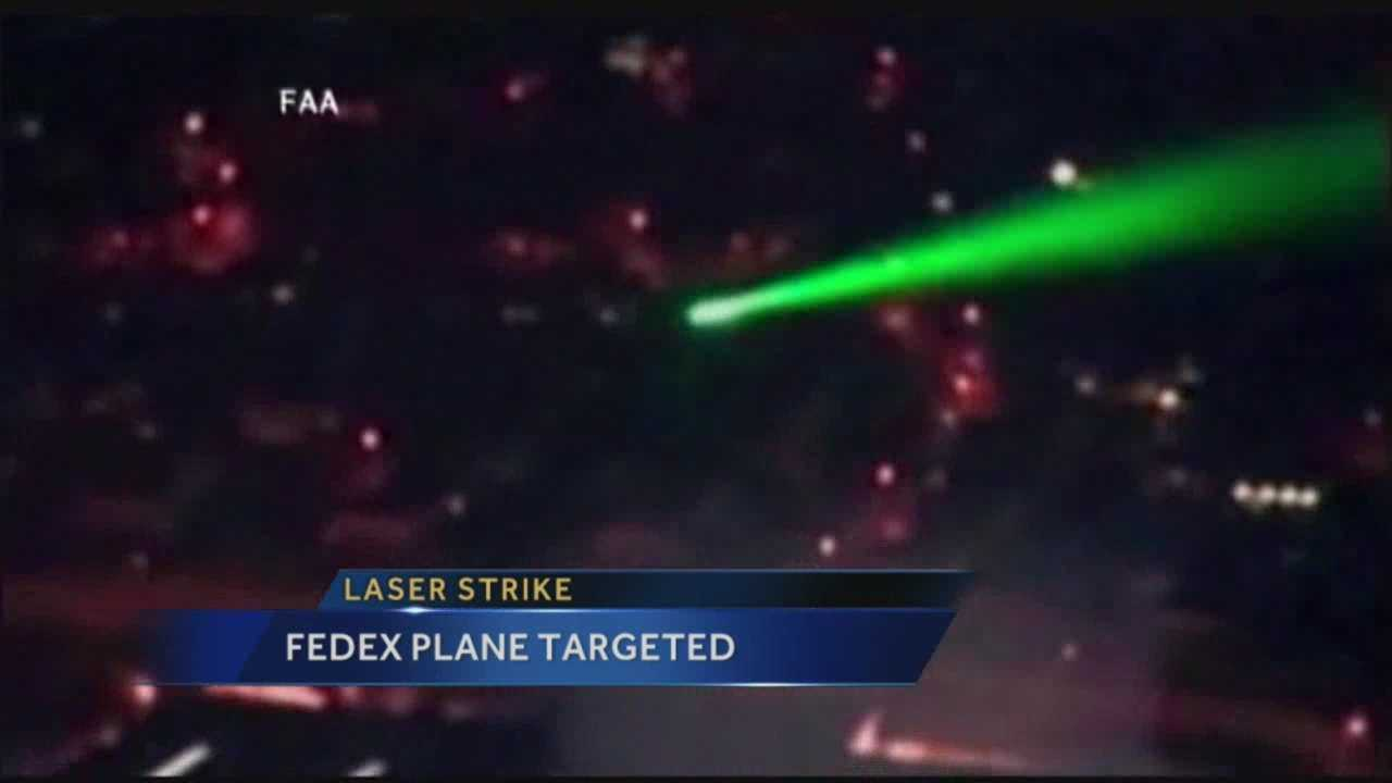 Pilots in a FedEx cargo plane were injured when someone shined a laser at the cockpit during landing at the Albuquerque Sunport.