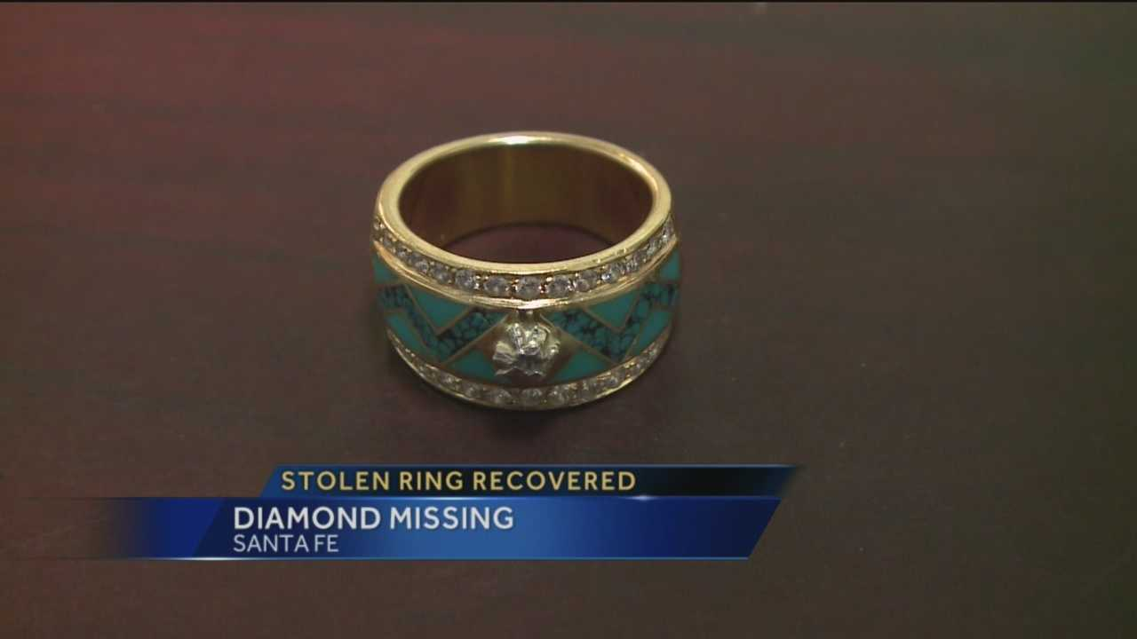 A $35,000 ring stolen from a shop in Santa Fe has been recovered, but it's missing an expensive diamond.