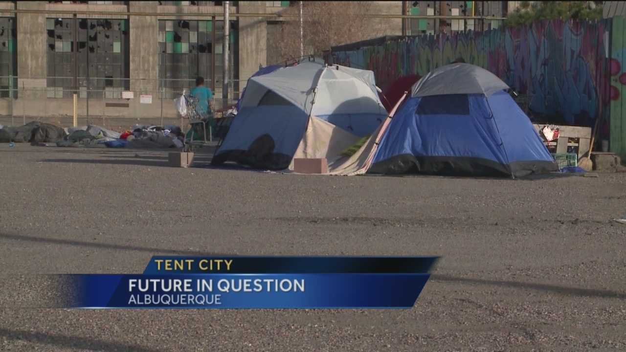 A neighborhood group invited homeless campers to stay on a lot they didn't own, but it's not up to the city to get them out of there.