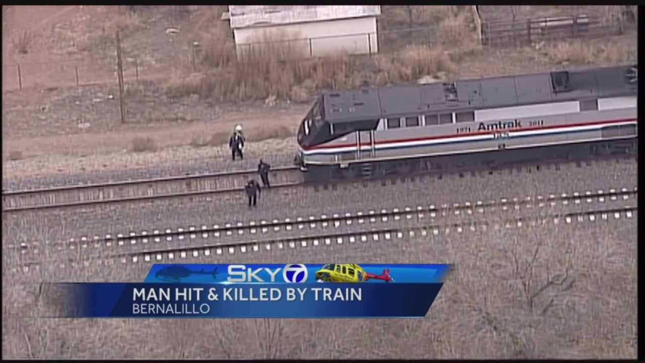 Officials said the man hit and killed by an Amtrack train in Bernalillo was lying on the tracks.