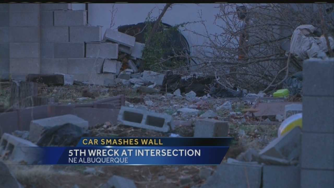 A car slammed through a wall and into the backyard of a house in northeast Albuquerque early Thursday morning.