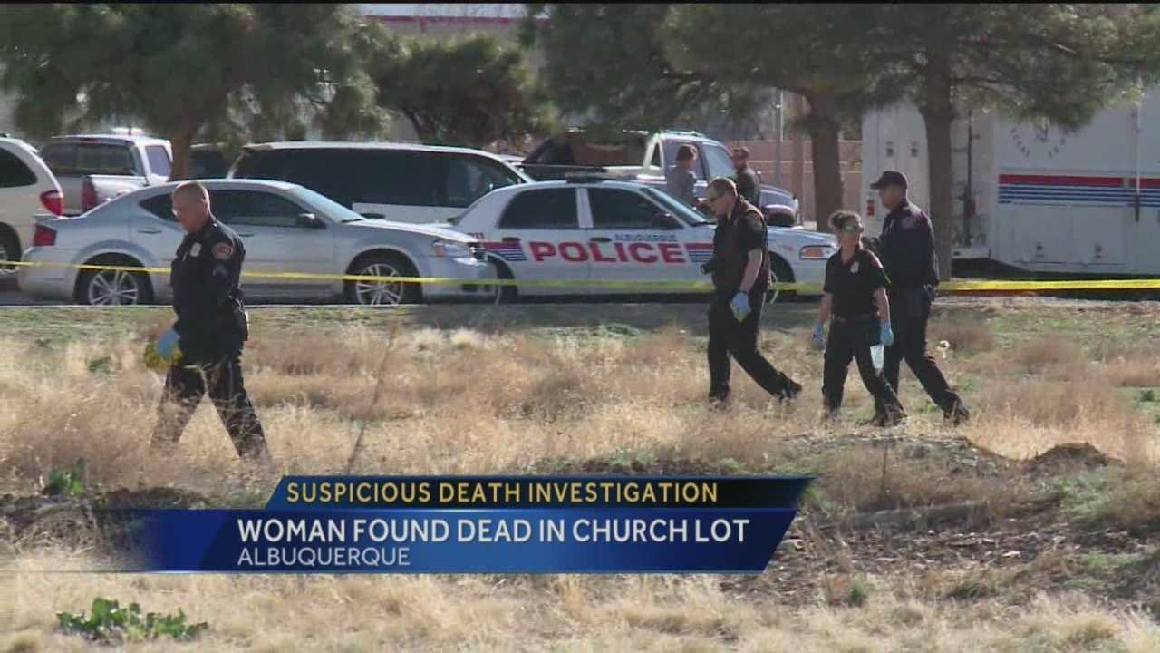 A woman's body found face down in a church lot. Police are calling her death suspicious.