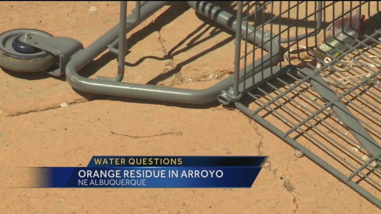 An orange residue found in an Albuquerque arroyo generated a lot of talk Monday.