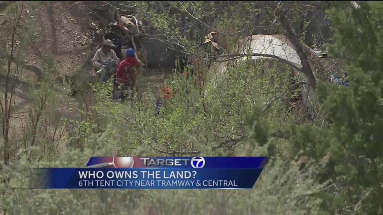 County officials say they think they've tracked down the people who own land near Tramway Boulevard and Central, where more than a dozen transients have set up a new Tent City.