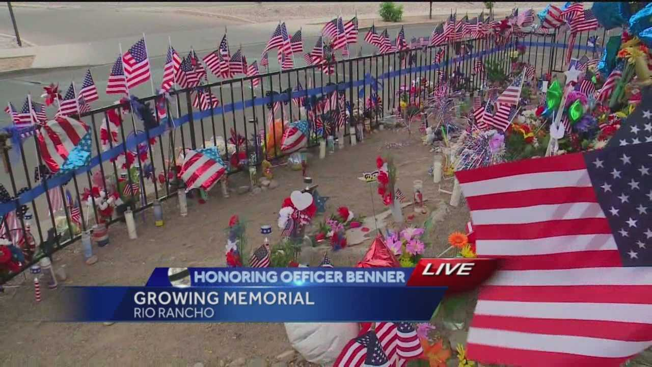 Rio Rancho officials are starting to sort through hundreds of items left at Officer Gregg Benner's memorial.