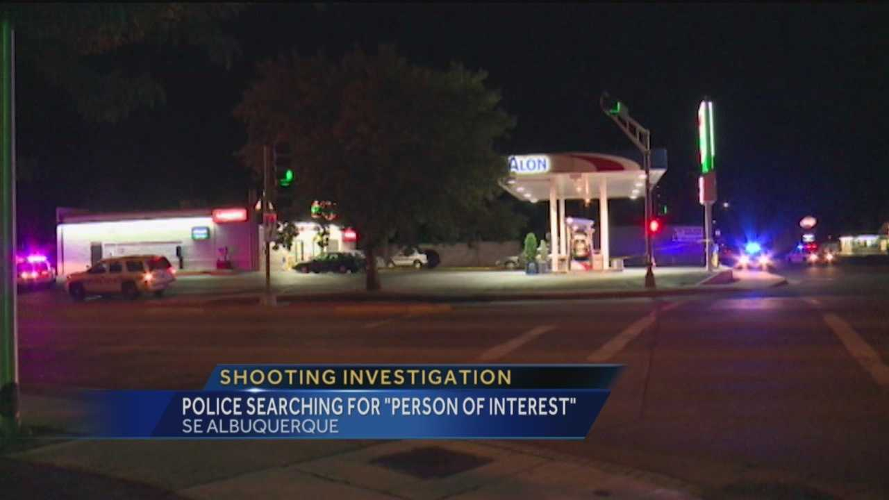 Police are searching for a person of interest after two people were shot outside a southeast Albuquerque gas station.